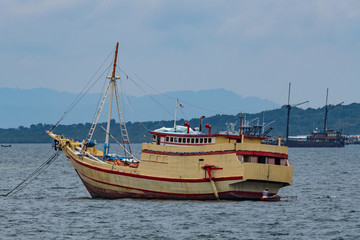 traditional wooden boat in port of Sorong, Raja Ampat, Indonesia