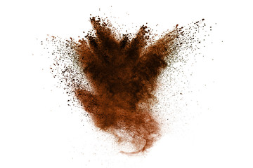 Freeze motion of brown dust explosion. Stopping the movement of brown powder. Explosive brown powder on white background. Wall mural