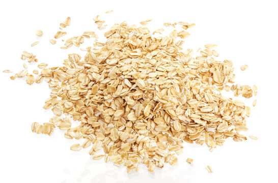 Pile of oat flakes isolated on white background. Top view