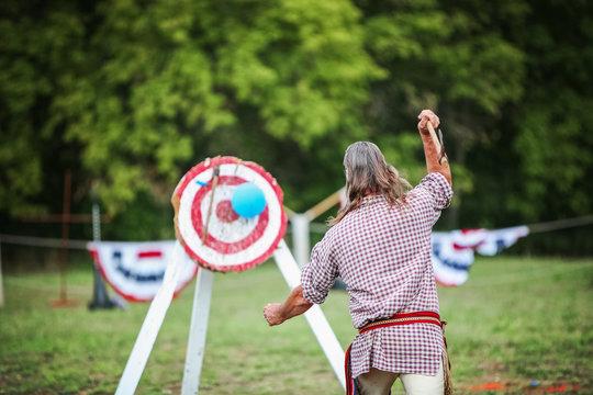 Man throwing an ax at a target