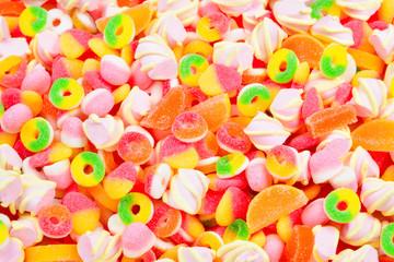 Assorted gummy candies. Top view.