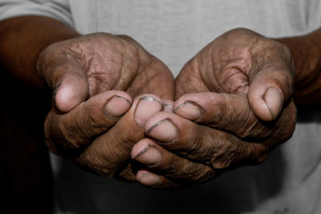 Hands poor poverty elder man begging you for help. Concept hunger people or poverty. Selective focus. Poverty in retirement.