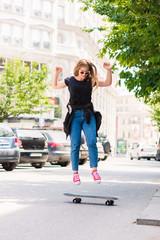 Teenage girl having fun with skateboard