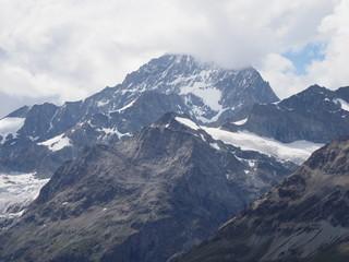 Briliant geological panorama of alpine mountains range landscape in swiss Alps at SWITZERLAND