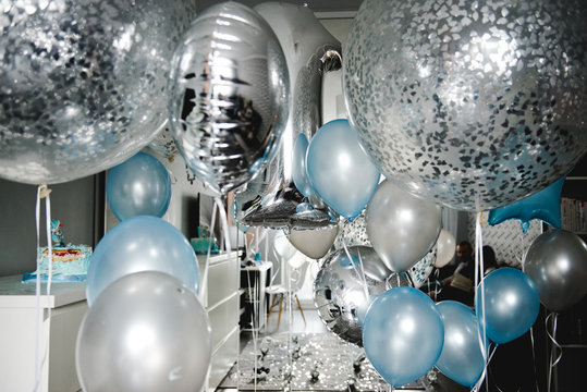 Birthday party in blue and silver. Many different balloons