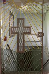 Crucifix on prison church gate