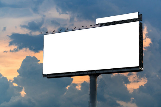 Big white billboard on the street in the sunset . Sky background. Copy space.