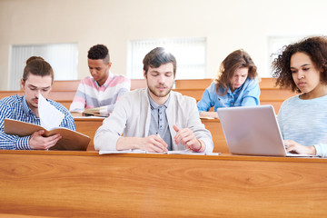 Group of multinational students sitting at lecture hall