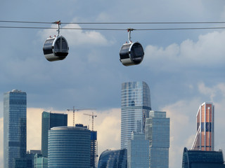 New cable car cabins in the Luzhniki against skyscrapers of Moscow-city in Russia Wall mural