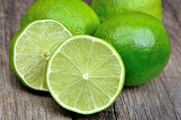 Heap of limes on vintage wood table
