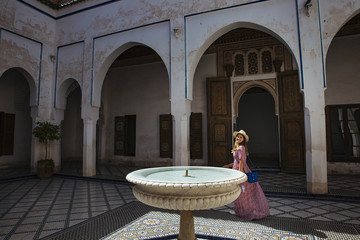 Caucasic girl with long dress and hat at Bay Palace
