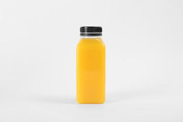 Bottle with delicious fresh juice on white background