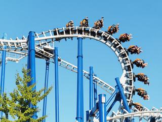 Foto op Aluminium Amusementspark Upside down rollercoaster fun ride amusement park