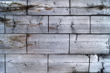 Wooden texture, old boards with a rough surface, horizontal rows with transverse cuts.
