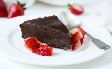 Piece of chocolate cake served with strawberries