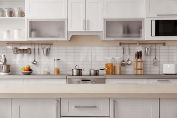 Countertop and blurred view of kitchen interior on background