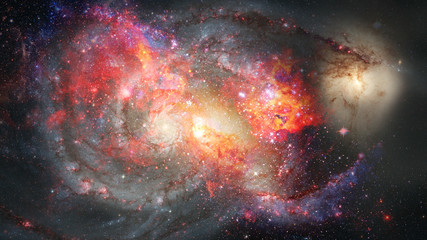 Nebula and spiral galaxies in space. Elements of this image furnished by NASA.