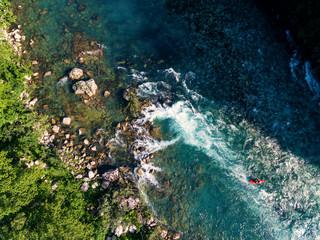 Kayaker kayaking on wild river.Aerial view