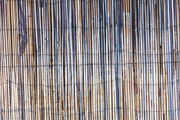 Brown bamboo fence close up