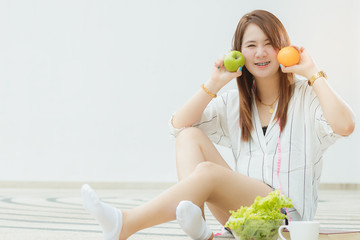 beautiful Asia teen girl holding vegetables  and fruits posing,make gestures with fun and happy.
