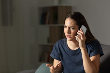 Frustrated woman claiming on the phone in the night