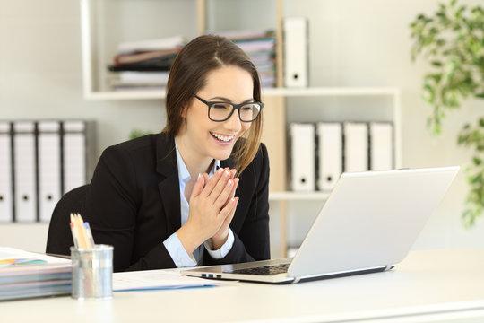 Happy office worker receiving good online news