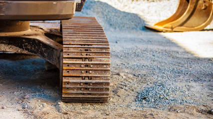 Detailed closeup of caterpillar track in industrial machine