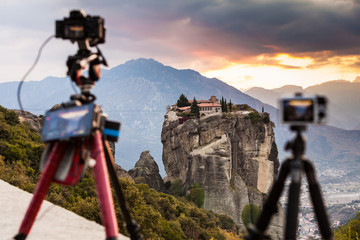 Camera on tripod and Meteora monasteries