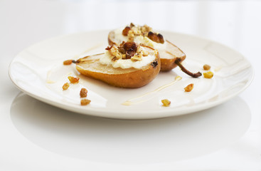 pear with ricotta on white plate