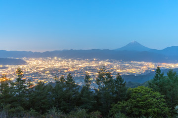 Mt.Fuji and Kofu city with sunrise sky seen from Mt. Amariyama view point.