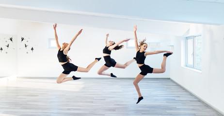 The group of beautiful girls practicing modern ballet dance.