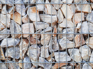 Metal grid with stones