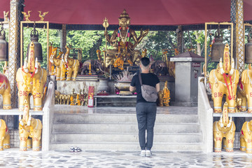 Religious guy praying at a buddhist temple in Hat Yai Thailand