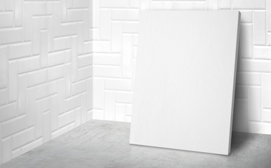 Blank poster at corner studio room with white tile wall and concrete floor background,Mock up studio room for display or montage of product for advertising on media,Business presentation.