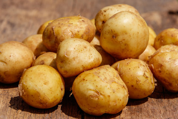 New potatoes on rustic wooden table