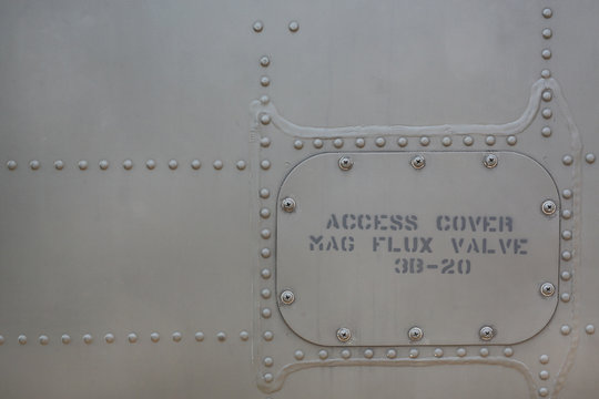 Metal surface background of military aircraft with cover.