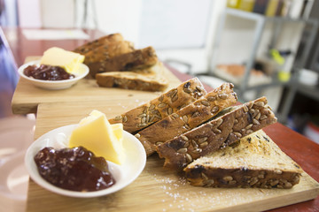 Tosted grain bread with butter and jam