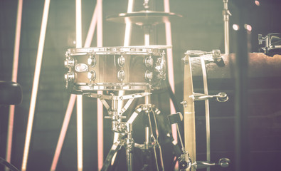 Drum set in a recording Studio or concert hall. Beautiful blurred background of colored lanterns. Musical concept.
