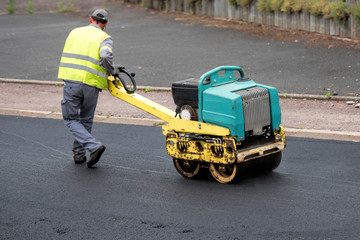 tamp new tarmac on the road