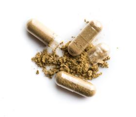 Herbal medicine powder in capsule on white background
