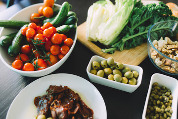 Vegetables and olives on table for salad cooking, healthy food