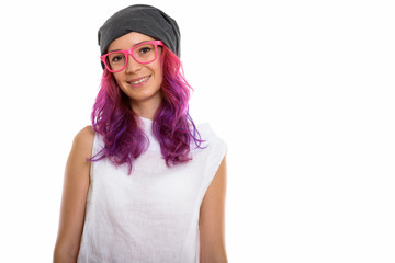 Studio shot of young happy woman smiling while wearing pink eyeg