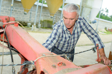 Farmer working on machinery