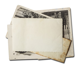 Stack of old photos. Isolated on white background with clipping path included.