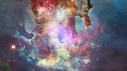 Nebula and stars in outer space. Elements of this image furnished by NASA