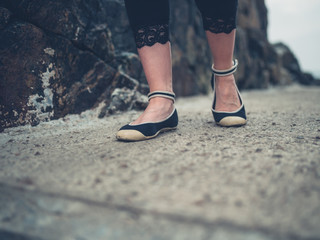 Feet of young woman walking outdoors