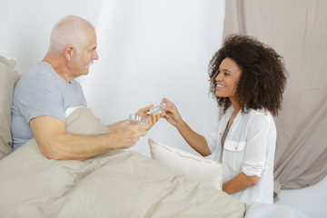 geriatric caregiver helping old man