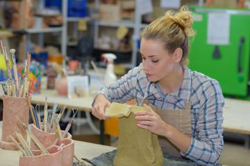 Female artist sculpting