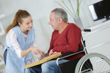 woman serving a man on the wheelchair