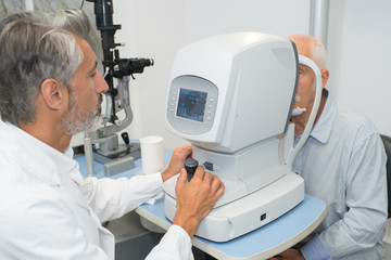 Senior man having eye test